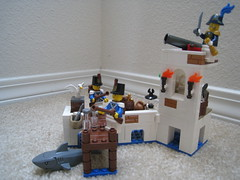 Soldier's Port (jgiese626) Tags: lego moc building fort harbor port docks tower soldier bluecoat governor shark cannon inkwell bust map bottle flask chair seat desk torch lantern sack barrel crate fish seagull crystal masonry bricks sword cutlass flintlock musket