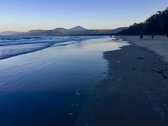 Four Mile Beach @ dusk (Marian Pollock) Tags: portdouglas beach iphone fourmilebeach shoreline queensland australia mountains shallows people dusk reflections sunset tranquil shade sky