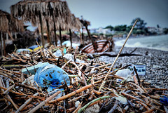 A non-touristic image (jimiliop) Tags: beach disaster natural cyclone garbage plastic umbrellas dirty kiato greece reeds branches mess