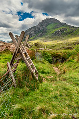 Stile To Tryfan Mountain (Adrian Evans Photography) Tags: grass snowdonia tryfanmountain ogwenvalley wales carneddaumountains british trail sky gate footpath valley welshlandscape cwmidwal landscape snowdonianationalpark welshmountain ogwen walkway clouds ladderstile welshlandmark summit steps track path adrianevans uk glyderaumountains landmark stile fence northwales tryfan mountain nikon 20mm
