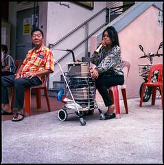 She s a market singer (waex99) Tags: 2018 500cm 800iso 80mmf28 cinestill hasselblad singapore analog film september man woman people street singer popular market public chanteur chanteurse femme marché populaire asie asia singapour dailylife