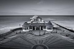 Cromer Pier (Johnners61) Tags: cromer pier norfolk england britain uk blackandwhite mono monochrome bw samsung nx mini wideangle 24mm pattern patterns wave waves sea coast ocean coastline seaside symmetry symmetrical