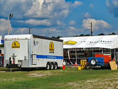Trailer And Kitchen. (dccradio) Tags: lumberton nc northcarolina robesoncounty outdoor outdoors outside sky bluesky cloud clouds cloudformation september sunday afternoon fall autumn hydepark hydeparkbaptistchurch hurricaneflorence reliefstation disasterrelief naturaldisaster hurricane florence trailer ncbaptists baptistmen baptistsonmission grass lawn yard ground dirt sand tent portablekitchen pylon cone canon powershot elph 520hs
