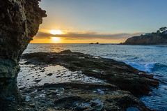Tidepools by the Cliff (SCSQ4) Tags: cliff clouds cloudy goldenhour lagunabeach northcrescentbaybeach rocks rocky seascape shoreline sun sunrays sunset