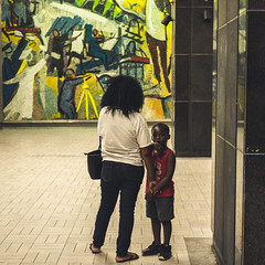 A mother with her child (andyjouvil) Tags: montreal metro mother son andy jourdainvilbrun canada quebec world street photography fujifilm xt100 35mm fujinon f2 candid going collecting souls faces moments decisive moment creative commons flickr flickriver explore scout best camera prime lens portrait scene fotografie city snap unposed crop streettog tog town look holding hands
