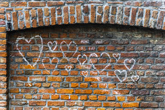 Love, love, love! (Alan Headland) Tags: belgium city flanders europe buildings architecture sony a6000 antwerp antwerpen brickwork graffitti wall pointing hearts