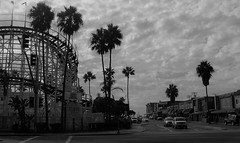 Big Dipper Corner (Rand Luv'n Life) Tags: odc our daily challenge corner mission blvd west bay drive belmont park amusement big dipper roller coaster palm trees building shops street clouds sky monochrome blackandwhite outdoor