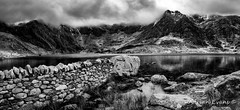 Idwal Lake Snowdonia (Adrian Evans Photography) Tags: winterlandscape snowdonia winter idwal water panorama glyderfawr idwallake glyderfach uk northwales sky glyderau wall glyderaumountains welshlandscape cwmidwal landscape snowdonianationalpark welshmountain ogwen reflections mono february llynidwal clouds stream worldheritagesite snowcapped adrianevans landmark wales nationalpark mountains outdoor blackandwhite snow rocks nikon 20mm d850