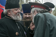 blessing of Cossack (Lyutik966) Tags: blessing cossack priest people religion crucifix man scene sacrament clothing cassock emotions smile beard chain russia moscow