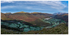 Early Morning over Borrowdale, The Lake District (dandraw) Tags: borrowdale derwentfells honisterpass rosthwaite thelakes thelakedistrict cumbria skiddaw panoramic pano panorama frost fields woods woodland autumn autumncolours mountains sky clouds outdoors landscape