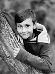 Monochrome portrait of a young boy (andypf01) Tags: person human boy young portrait naturallight iphonexs monochrome blackandwhite woodland tree bokeh