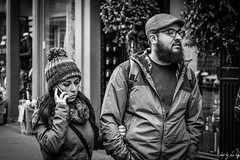 On the Blower (Cycling-Road-Hog) Tags: beard blackwhite candid canoneos750d citylife colour couple efs55250mmf456isstm edinburgh fashion hat mobile monochrome people phone places royalmile scarf scotland street streetphotography streetportrait style urban
