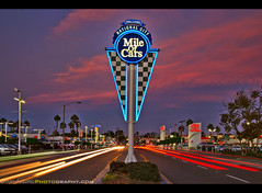 Sunset Along the National City Mile of Cars (Sam Antonio Photography) Tags: mileofcars nationalcity sandiego california night traffic street travel neon sign illuminated city highway longexposure transportation road cityscape blur cars streak dusk attraction dark landmark motion lights urbanscene neoncolor travellocations traveldestinations vibrantcolor lightstreaks urbanroad multiplelanehighway lighttrail boulevard car headlights famousplace destination