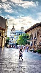 Cyclist in Oviedo, Spain (Randy Durrum) Tags: spain plaza pavement bicycle cyclist bicylclist sky cloud clouds cloudy durrum s9 samsung oviedo asturias camino primitivo de santiago