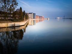 Autumn morning (Maria Eklind) Tags: bluesky building malmö cityview spegling sky water reflection himmel autumnmorning sweden skånelän sverige se sea boat city dusk tree
