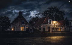 1794 and 1758 (Oosterburen) (VandenBerge Photography (and we're back again)) Tags: schiermonnikoog oosterburen nationalpark westfrisianislands friesland thedutchwaddenseaislands town historical building houses lights evening sky clouds mystic atmosphere canon eos80d langestreek unescoworldheritage waddenseaworldheritage thenetherlands europe