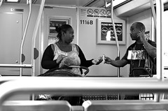 Ten for Twix a.k.a. Please Don't Buy From Vendors (Pedestrian Photographer) Tags: 50 50mm dsc4142 vendor twix ten cash compton candid aa africanamerican money pay paying buying la metro blue line ghetto los angeles train sunday beer crawl september 2018 ribbet black white bw street