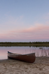 Canoe Sunset (Ben Aerssen) Tags: millerlake brucepeninsula ontario canada sunset canoe sand reeds shore treeline lake water canadian boat pink blue magenta purple sky clouds oar