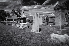 A Sad Chapter Forgotten In Most History Books (Mike Schaffner) Tags: native american reign terror bw blackwhite blackandwhite burialground cemetery clouds grave gravestone graveyard indian killersoftheflowermoon memorial mollieburkhartcobb monochrome monument osage tombstone