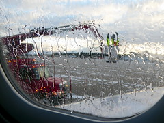 De-icing (yooperann) Tags: airplane window red truck deicing marquette sawyer international airport upper peninsula michigan