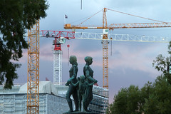 Women holding hands with children and the cranes (smir_001) Tags: statue sculpture fountain industrial architecture history historical akerbrygge oslocityhall radhusplassensquare children women dusk sunset tourism twilight attraction city capitalcity oslo norway norway2018 canoneos7d landscape outdoor modern attractive unique august summer
