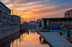 Sunset in Milan (Emu Alim) Tags: milan italy sunset warm reflection sky darsena navigliogrande naviglio lombardy