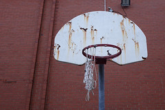 Sad basketball (Coastal Elite) Tags: decrepit basketball court rusted hoops rim basket sport schoolyard backboard board old torn net facilities installation rusty oxfordschool halifax novascotia oxford school westend école education elementary empty outdoor summer abandoned deserted vacant outside urban pavement sad brick wall