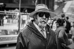 In the Shades (Leanne Boulton (Away)) Tags: portrait urban street candid portraiture streetphotography candidstreetphotography candidportrait streetportrait streetlife man male face expression mood feeling atmosphere sunglasses hat raincoat weather tone texture detail depthoffield bokeh naturallight outdoor light shade city scene human life living humanity society culture lifestyle people canon canon5dmkiii 70mm ef2470mmf28liiusm black white blackwhite bw mono blackandwhite monochrome glasgow scotland uk