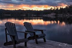 Twilight (Lindaw9) Tags: westarmoflakenipissing shanty bay french river district northeastern ontario lake sunset twilght treeline reflections adirondack chairs dock sky