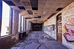 Hallway (jkotrub) Tags: urbex urban explore decay architecture rust dust indoors inside damage graffiti texture photowalk beauty lines time rubble derelict wall brick door masonry wooden worn concrete