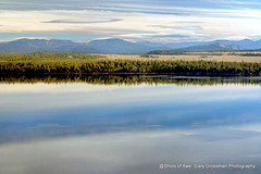 Morning Blues (Gary Grossman) Tags: lake water reflections clouds tetons mountains park landscape wyoming garygrossmanphotography greattetonnationalpark greattetons jennylake nationalpark autumn fall