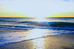 Wave in backlight (Fnikos) Tags: sea water mar mare wave ola ocean landscape seascape coast beach bay shore seashore sand light backlight contraluz sky wind skyline outdoor