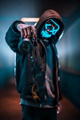 Invasion (KurteeQue) Tags: portrait moody mood mask nikon city streets strobe lighting d850 d750 subject fence exposure