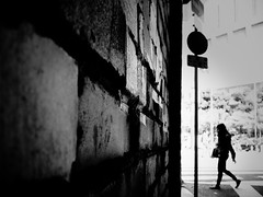 Crosswalk (明遊快) Tags: street alley japan woman walking pattern silhouette urban composition wall bw