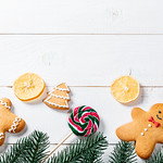 Funny gingerbread men with tree branches and candy thumbnail