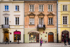 Warsaw, Poland-March 20, 2018: Nowy Swiat, main fashionable street in Warsaw, people walking, woman standind on the street. (Nikos Stamos photography) Tags: nowy poland architecture attraction beautiful bicycle bike blue brick building capital center city cityscape classic color colored colorful culture day destination district downtown editorial europe european exterior famous heritage historic historical history holiday houses landmark old orange outdoor people polish polska red road scenery scenic sightseeing square standing store stores street swiat tour tourism tourist town travel urban view visit warsaw window windows winter
