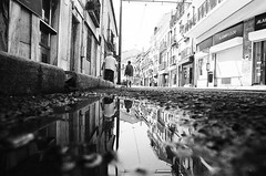 Falling in (ewitsoe) Tags: analog monochrome mono bnw blackandwhite city puddle reflection nikonfm2 fm2 50mm street urban reflections reflect sidewalk peopel walking travel portugal lisbon lisboa vacation workshop fujifilm grain illford tmax hp5plus