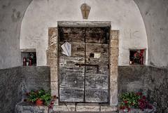Chiesetta della Madonna della Cona (Eric@focus) Tags: church chiesetta italy marche graffiti door cross candle lock wood flowers red earthquake damaged disaster 2016 religion catholic forcadigualdo
