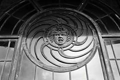 R3-021-9 (David Swift Photography) Tags: davidswiftphotography newjersey asburyparknj carouselasburypark windows architecturaldetail sculpture 35mm ilfordxp2 nikonfm2 jerseyshore beauxarts