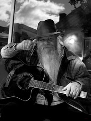 """Guitar Buck"" (photo_secessionist) Tags: portrait guitar man homeless travelling hat fedora guitarbuck fredericksburg virginia street human musician music pentax pentaxdaf35561855mmallens digital blackwhite bw bn 100strangers"
