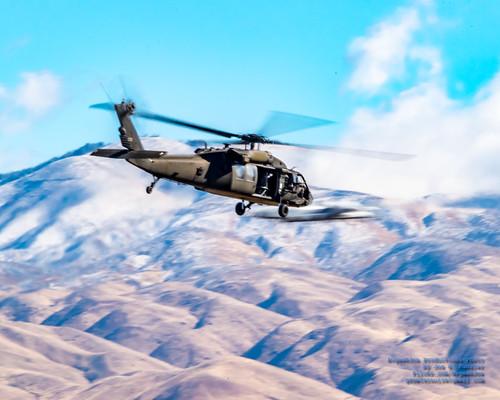 UH-60L Black Hawk Flying While A-10 Warthog Buzzes By