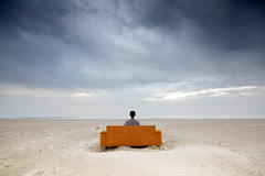 Serenity (FX-1988) Tags: beach self calm empty landscape sofa clouds winter sad dramatic lonely loneliness water sand sunset orange furniture nowhere gnd