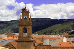 The belfry and the storks (ricardocarmonafdez) Tags: málaga andalucía antequera cielo sky nubes clouds light shadows sunlight tejados roofs ciudad city village town cityscape landscape mountain campanarios belltower belfry bulrush buildings canon 60d 1785isusm