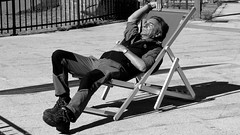 The Deckchair. (Neil. Moralee) Tags: italyneilmoralee neilmoralee man old mature elderly rest sleep doze nap sunshine warm shadow deck deckchair chair bw bandw blackandwhite mono monochrome face candid italy sun seat sitting lazy folding snore neil moralee olympus omd em5 street madonna di campiglio tires exhausted afternoon