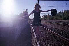 N0784512 (.e.e.e.) Tags: yashicat3 carlzeissttessar2835 compact analog analogue rails epsonperfection4490photoscanner film filmscan fujicolorc200 balance backlight blue railway hat girl miniskirt model detty
