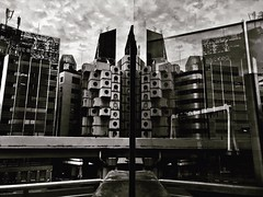Nakajin Capsule Tower reflected (Alfie | Japanorama) Tags: japan tokyo nakajin blackandwhite monochrome iphone iphoneography architecture