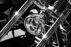 Harley chop headlamp (Explored) (G. Postlethwaite esq.) Tags: bw dof derbyshire harleydavidson heage sonya7mkii beyondbokeh blackandwhite bokeh chopper classicbikes depthoffield fullframe headlamp mirrorless monochrome motorbikes photoborder selectivefocus windmill
