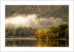 The last wisps - (Sigma, 100-300mm, f11) - 2018-10-01st (colin.mair) Tags: 100300mm autumn derwentwater forest lens manual sigma uc yellow border f11 fog frame green pk trees water