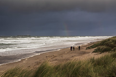 A walk on the wild side (andyrousephotography) Tags: bamburgh bamburghbeach northumberland seascape sea waves surf people walking farneislands storm rainbow grasses windy gale hail rain