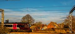 Turbostar (Peter Leigh50) Tags: train trees railway railroad rail town house petrol station turbostar fujifilm fuji xt2